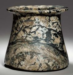 AN EGYPTIAN ROSE GRANITE VESSEL PREDYNASTIC PERIOD, NAQADA I, CIRCA 4000-3600 B.C.  - amazing creation at this point in history