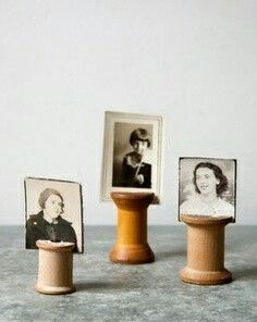 Repurposing vintage, wooden thread spools to display old family photos. Elle @ Leau Arc