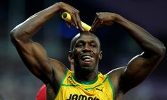 Even Usain Bolt has caught Mo mania! He does the Mo-bot after storming across the line to win the Men's 4x100m Relay for Jamaica in a world record time. Photograph: Owen Humphreys/PA - http://www.PaulFDavis.com/success-speaker (info@PaulFDavis.com)