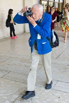In celebration of legendary fashion photographer Bill Cunningham's birthday, we've picked 13 pictures of the icon at work: