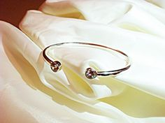 A personal favorite from my Etsy shop https://www.etsy.com/listing/116557675/sterling-silver-28-carat-cz-cuff