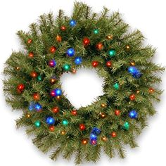 The Norwood Fir Wreath by National Tree Company features a thick, full branch design. Pre-lit with multi-colored energy-efficient and long-lasting battery-operated LED lights, it comes with a handy built-in timer that runs 6 hours on and 18 hours off. Christmas 24, Christmas Lights, Christmas Decorations, Xmas, Christmas Central, Outdoor Christmas, Christmas Ideas, Winter Holiday, Christmas Projects