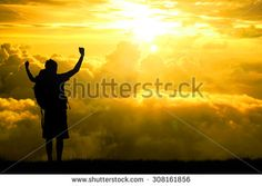 Silhouette of men backpacker open arms raised towards on hope sky at sunset light effect ,Concept for life achievements and success