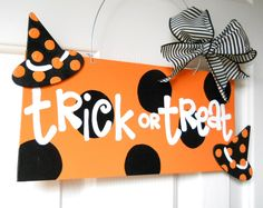 Trick or Treat Halloween polka dot sign with witch hats.
