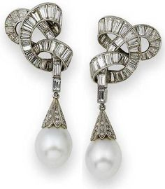 A pair of cultured pearl and diamond pendent earclips, by Van Cleef & Arpels, circa 1950.