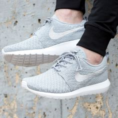 watch 7bc5c f52ce Constructed from a lightweight flyknit upper, the Nike Roshe NM Flyknit  Trainer. Flyknit Trainer