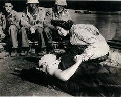 Flight nurse Jane Kendeigh and wounded Marine. Iwo Jima, 1945.