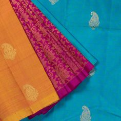 """The """"Sea #Blue"""" #handwoven Kanjivaram Silk Sari from Kanakavalli is woven with gold zari paisley motifs all over the body. A Section of #Magenta with zari floral motifs makes up the attractive pleats. An attractive gold zari adorn the blue pallu. The blue blouse completes the sari."""