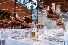 Florals by Wyld Orchids Table Numbers & Candles by The Stylist's Guide Tables, Napkins and Chairs by Modern Party Hire