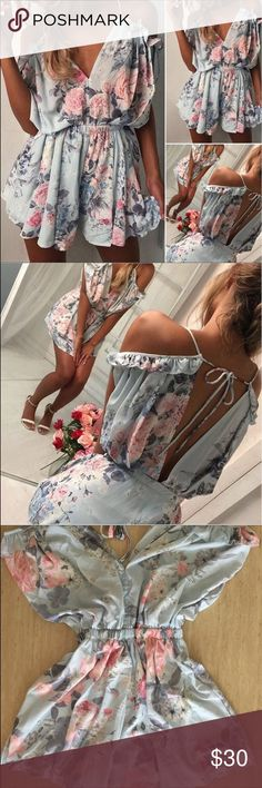 Pink blue floral jumpsuit romper casual shorts Pink blue floral jumpsuit romper casual shorts. Size S. Cute and sexy. Material: polyester. V neck. Loose style so it fits size M too. Dresses Midi