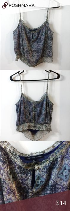 "NEW American Eagle Blue Bohemian Crop Top NEW WITH TAGS  American Eagle Blue Bohemian Adjustable Crop Top    Little slit with button at cleavage, very comfortable and cute for day or night outings! Paisley like pattern of blue. Fully Adjustable Straps.  Size Medium  Last pic is to show fit in the same top but different color and size. Model is wearing a size XS  Length 20"" bust 32"" American Eagle Outfitters Tops Crop Tops"