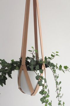 hanger leather, ceiling planter, leather geometric hanging planter, vegetable tanned leather natural including white plastic pot Plant hanger nude leather ceiling planter leather by AmulettesPlant hanger nude leather ceiling planter leather by Amulettes Plastic Pots, Plant Holders, Hanging Planters, Vegetable Tanned Leather, Natural Leather, Indoor Plants, Indoor Outdoor, Patio Plants, Houseplants
