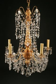 Antique 6 arm iron and gilded wood crystal chandelier. #antique #chandelier #crystal #iron