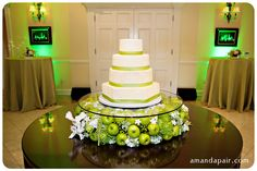 love this basic idea to lift the cake.... I would do it with all florals and rose petals underneath....