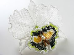 White beadwoven cattleya orchid. Beautiful! Surprised at how large it is - 12 cm (~5 inches).