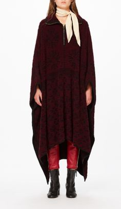 Shop now. Chloé Fleece Poncho. Clare Waight Keller's Chloé FW collection was inspired by French journalist and motorcycle adventurer Anne-France Dautheville who wore ponchos when riding her motorcycle. Cut for an oversized drape, the luxurious oxblood fleece is toughened up with brass rivets and zips. Wear nonchalantly over leather.