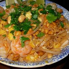 "Authentic Pad Thai Allrecipes.com  ""Inspired by the pad thai at Thai Tom, this recipe features a tamarind paste, vinegar, sugar, and fish sauce mixture over perfectly stir-fried eggs, chicken breast, and rice noodles, garnished with peanuts, chives, and fresh bean sprouts."""