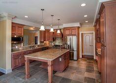 Grand kitchen with central island! The Evangeline - 1137. http://www.dongardner.com/plan_details.aspx?pid=3096. #Kitchen #Island #HomePlan