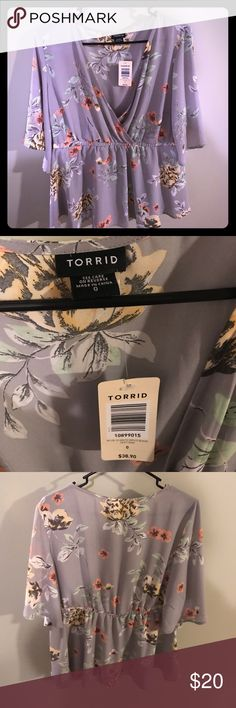 Torrid Floral Blouse This blouse is brand new with tags! torrid Tops Blouses