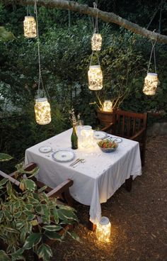 Festive outdoor space...all it takes is a bit of lighting, a crisp tablecloth, good food and good company.