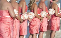Pink bridesmaid dresses with simple bouquets. ALC Wedding Photography http://www.outerbanksweddingassoc.org/membersearch/memberpage.html?MID=2058=Photographer=16 #pinkbridesmaiddresses #obxwedding