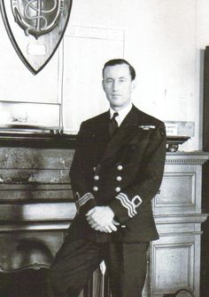 Ian Lancaster Fleming clad in his naval uniform in Room 39 of the Admiralty, the nerve centre of the Naval Intelligence Division.