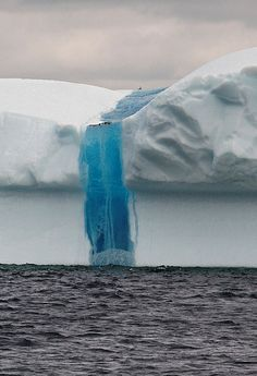 Iceberg showing the melted and refrozen bright blue lines in St. Nature Pictures, Cool Pictures, Cool Photos, What A Wonderful World, Beautiful World, Gros Morne, Photos Voyages, Natural Phenomena, Newfoundland
