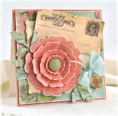 cosmocricket. Love the stitches & postcard. Love the layered flower.
