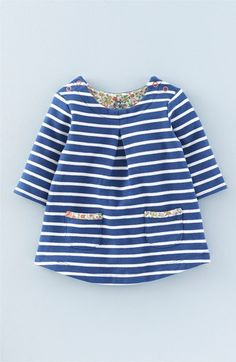 Free shipping and returns on Mini Boden 'Sweatshirt' Brushed Cotton Blend Dress (Baby Girls & Toddler Girls) at Nordstrom.com. A charming dress that's cut from a supersoft brushed-cotton blend—so it feels like a favorite old sweatshirt from the very first wear—is patterned in sweet stripes and features two contrast-trimmed pockets near the hem for storing found treasures.