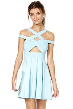 Things are about to get really cute. This light blue dress features strappy detailing, a cutout at center, and pleating at skirt. Stretch fabric, zip/hook closure at side. Unlined. Toughen up this adorable dress by pairing it with a moto jacket! By Nasty Gal.