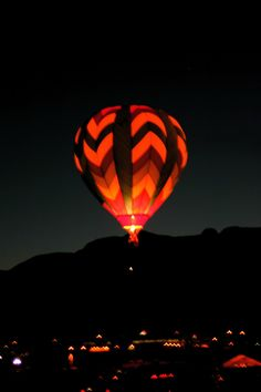 Albuquerque, New Mexico - Balloon Glow at the Albuquerque Balloon Fiesta Photo Credit:  Randy Toltz, AdjustYourLatitude.com