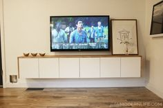 DIY Floating Sideboard by Petite Modern Life >>and Ikea hack! - Ikea DIY - The best IKEA hacks all in one place Floating Tv Cabinet, Floating Tv Stand, Floating Shelves Diy, Scandi Living Room, My Living Room, Tv Furniture, Classic Furniture, Painted Furniture, Furniture Stores