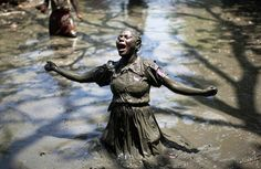 A Voodoo believer goes into a trance at a mass ritual during the Plain Du Nord Festival July 24, 2009. Thousands of believers in Haiti sacrifice animals and pray in mud pools during the festival to ask the voodoo spirits for help with money, the future and children.