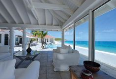 "CARISA http://www.stmaarteninvestments.com/real-estate.aspx?id_villa=165&type=sale&utm_source=Pinterest&utm_medium=web&utm_campaign=Magic+Bullet Terres Basses - French Lowlands, St. Martin 2 BRs, 2.5 BATHs on Baie Rouge Beach, this house is a gorgeous mix of contemporary and Caribbean styling. It is fully air-conditioned, and has a media room with a 60"" plasma TV, and top quality THX audio both for watching DVDs or listening to music outside by the pool or in the raised, heated Jacuzzi."