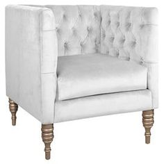 """Pine-framed accent chair with tufted velvet-inspired upholstery and foam cushioning. Handmade in the USA.  Product: ChairConstruction Material: Solid pine, polyurethane and polyester fill foamColor: Velvet whiteFeatures: Handmade in the USADimensions: 33"""" H x 33"""" W x 28"""" D Note: Easy assembly requiredCleaning and Care: Spot clean only"""