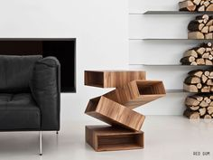 Side table with wooden balancing boxes #sidetabledesign modern design #creativefurniture living room design #modernsidetable modern living room. Find more inspirations at our blog www.coffeeandsidetables.com