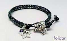 Black leather and purple bead bracelet with skull button £10.00