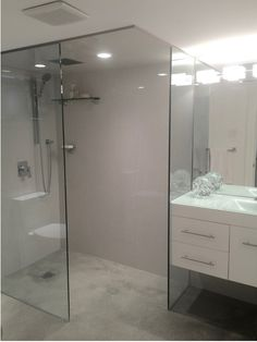 one piece shower faucet. Basement bathroom  Porcelain wall tiles glass top vanity hand shower modern one piece