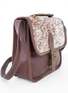 Austin Ponyhair Satchel is bringin' the country back! In such a cute easy to wear style!