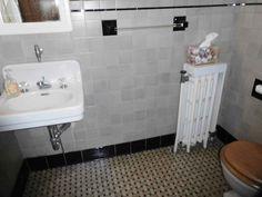 1929 art deco bathroom in grey and black.