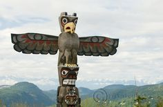 A First Nations totem pole sits atop the Malahat on the Trans-Canada Highway near Victoria BC.