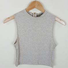 Mock neck crop top A comfy cute top that can be dressed up or wear in a casual sunny day  Content 95% rayon 5% spandex  Gold zipper , ribbed material  #ribbed #tanktop #croptop #sleeveless #mockneck #zipper Tops Crop Tops