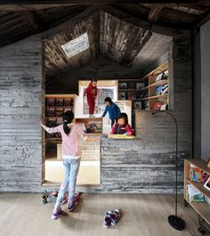 2016 Aga Khan Award for Architecture Winners Announced,Hutong Children's Library and Art Centre / ZAO / standardarchitecture / Zhang Ke. The 9m2 children's public library built of concrete mixed with Chinese ink was inserted underneath the pitched roof of an existing building. Image © AKTC / Zhang MingMing, ZAO, standardarchitecture