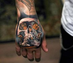 Manly Glowing Orange Skull Tattoo On Hand With White Ink