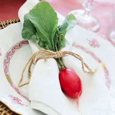 Love this charming place setting! Fold a radish or carrot into a napkin and use twine to tie the bundle together.