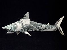 Almost any laminar material can be used for folding, but usually it's a plain paper. However, as we (humans and pandas) are very creative, it was not long before paper money became a popular material to create origami with - this is known variously as Dollar Origami, Orikane, and Money Origami.