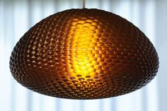 The Dragonfly.MGX pendant light was inspired by the curved honeycomb structure of insect eyes and their optical qualities. Designed by design studio WeltelOberfell .