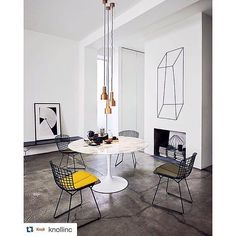 #Repost @knollinc.  Contemporary details modern classics and of course a spot of color. Featuring the Saarinen Table and Bertoia Side Chairs. | #bertoia #saarinen #designinspiration #ModernAlways #interiordesign #design #archiproducts #minimal