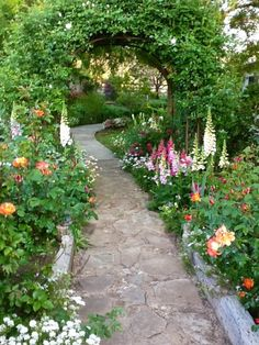 15 Awesome Gardens Ideas-i love the path idea and the flowers being all tall and close so you don't se the soil, so it looks sorta wild Beautiful Garden- design by Joy Hale. A Flea Market Gardening Garden Tour Meet Joy Hale Joy Wagoner Hale Could this und Garden Cottage, Diy Garden, Dream Garden, Garden Paths, Garden Landscaping, Landscaping Ideas, Backyard Ideas, Gravel Garden, Garden Arbor