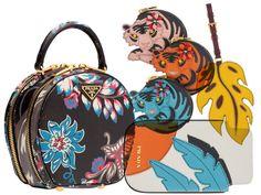 Prada Holiday 2013 Collection. Tiger change purses. OMFG.
